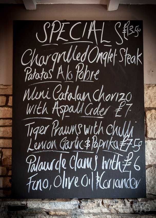 El Gato Negro food specials, blackboard, onglet steak, palourde clams, catalan chorizo, tiger prawns