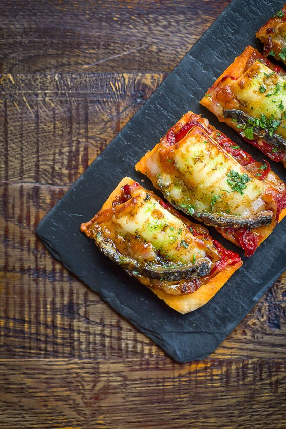 Coca Mallorquina: flatbread from Mallorca with red onion and pepper confit, Monte Enebro goats cheese