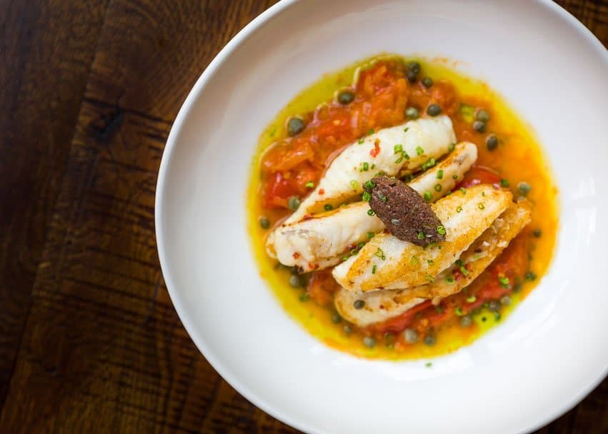 Baby monkfish fillets with LED tomato, shallot and mini caper sauce